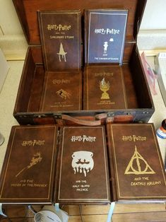 Made leather bound copies of the Harry Potter books for my wife for Christmas - Album on Imgur