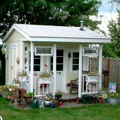 Why not turn your she-shed into a home-from-home with a porch, side entrance and its own flower garden?