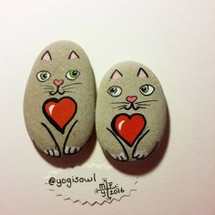 This is a really cute picture of two cat's or kitten's that are rock's with hearts in the middle of there chest.