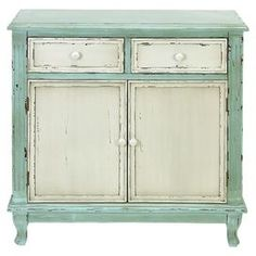 Cabinet with a warmly weathered finish.   Product: CabinetConstruction Material: Wood  Color: Mint and ivory    Dimensions: 33 H x 33 W
