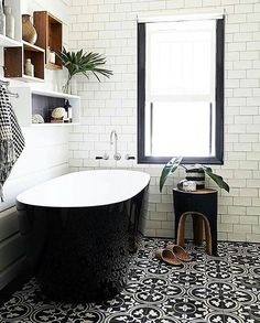 #repost @serie7co #welovenew We love the flooring in this bathroom, it pairs perfectly with the black exterior of the bath and contrasting white tiled walls. #bathroominspo #bathroomdecor #bathroomgoals #modernhome #interiordesign #interiorinspiration
