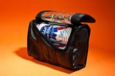 Green Guru Cruiser Cooler - The Cruiser Cooler is made from recycled innertubes and an upcycled reflective mylar insulated interior liner originally used for compostable cup packaging. Meant as an all purpose glove compartment for casual rides