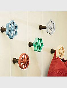 Faucet Hooks - I can see this in a potting shed!  OR how about using these as part of a mix of hooks in an entry way...the possibilities are endless!