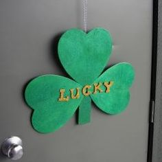 Glittery Shamrock Door Decoration from wooden hearts