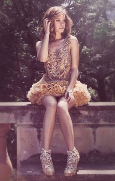 Hosted by FASHFORFASHION.com- I think her outfit is gorgeous but the picture is also very beautiful!