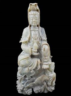 Kuan Yin Green-grey jade statue features a delicately carved deity atop a mythical water dragon with attendant, fish, waves and seashells. Orange and black suffusion. Jade, Water Dragon, Oriental Design, Porcelain Ceramics, Gems And Minerals, Vases Decor, Chinese Art, Deities, Green And Grey