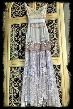 Make it out of slips - reminds me of Michelle Harders My Fair Lady Dress that she made out of thrift store wedding dresses.
