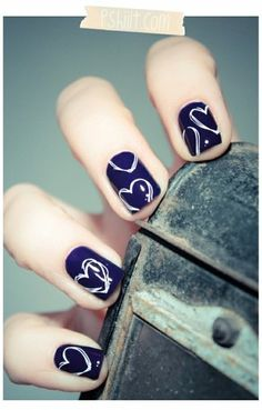 Paint nails white and let dry. Layer on navy polish, let stand for 5 minutes, then use a paperclip to make the design you want