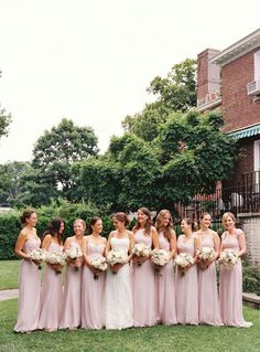 pretty lavender gowns on a bevy of bridesmaids.