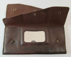 VINTAGE BROWN LEATHER HAND STRAP PURSE WALLET CLUTCH WITH VANITY MIRROR R11258 For more pictures of the same please visit any of my blogs: Tumblr  link   http://sangriasuzie.tumblr.com/ Wordpress blog link  http://sangriasuzie.org/ http://stores.ebay.co.uk/Sangriasuzies-Emporium http://www.sangriasuzie.com/ If any of the  items pictured in this blog/pin take your fancy they can be bought from one of the above addresses.  Or e-mail me at drobertshq@hotmail.com   if you need more info.