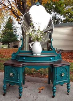 Antique refinished vanity in teal.  This color has come up in several refinished pieces. Looks great. I would never have been so adventurous as to try it without seeing this first