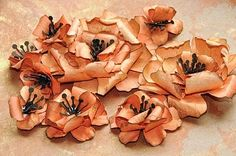 Swirly paper hibiscus flower tutorial, using Tim Holtz tattered florals Sizzix dies. http://media-cache2.pinterest.com/upload/112941903125318862_8E6CUAsj_f.jpg webspinstress assemblage altered mixed media