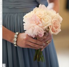 Blush rose and peony nosegays were a romantic contrast to the periwinkle bridesmaid dresses.