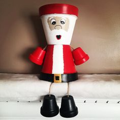 Custom Made Hand Painted Mr. & Mrs. Santa Claus Flower Pot Statue-6 each-approximately 12 total height The flower pots are custom made by hand so yours will be similar but not necessarily identical. If you have any ideas of a custom flower pot person youd like to add to your home message me with your ideas. Custom painted especially for you!! Flower Pots can be indoor or outdoor. I would suggest bringing them indoors during the winter months. Flower pots have been sealed. The letters...