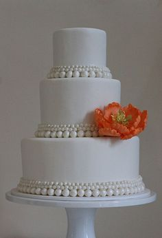 #7. This is s very simple design but the pearls really make it elegant.  Imagine more flowers on top. Perhaps the cake in alternating layers of pale pink and pale green with the white pearls.