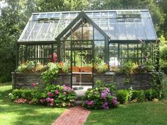 Traditional Landscape/Yard with picture window, Chalet greenhouse, Pathway, exterior tile floors, Raised beds, Skylight