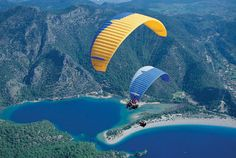 Enjoy breathtaking tandem Oludeniz paragliding flight with experienced pilot. Babadag mountain Fethiye paragliding in Olu Deniz Turkey. Tandem, Shimla, Places To Travel, Places To See, Tourist Places, Travel Pics, Wind Surf, Sr1, Hang Gliding