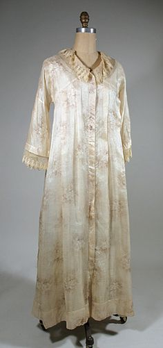 1910 Sheer Striped and Printed Silk Negligee. This complex fabric has a soft floral print on a woven striped ground plus a meandering floral woven into the fabric. It's a very lightweight silk and a bit sheer. The yoke is cut in one with the kimono sleeves, while the front has pleats for fullness and a full length hook and eye closure. The back is done Watteau style with boxed pleats falling from the shaped yoke. The bell sleeves and neckline both have lovely net lace to finish.