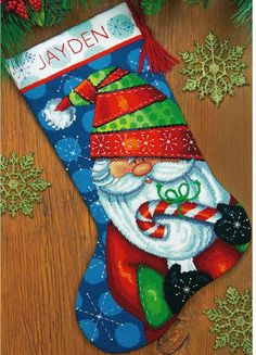 Dimensions Sweet Santa Christmas Stocking - Needlepoint Kit. This Sweet Santa Christmas Stocking in needlepoint by Dimensions features bright colors and a conte