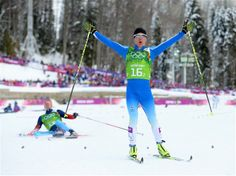 Sami Jauhojaervi of Finland celebrates as he crosses the line to win the gold medal with teammate Iivo Niskanen (not pictured), as Nikita Kriukov of Russia collapses in the snow, in the Men's Team Sprint Classic Final during Day 13 of the Sochi 2014 Winter Olympics at Laura Cross-Country Ski & Biathlon Center. Sochi 2014 Day 13 - Cross Country Men's Team Sprint Classic.