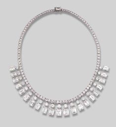 AN IMPRESSIVE DIAMOND FRINGE NECKLACE, BY CARTIER  Composed of twenty-one slightly graduated rectangular-cut diamonds, the five central diamonds weighing (from left to right) 1.79, 2.36, 3.06, 2.86 and 2.64 carats, the two smallest rectangular-cut diamonds weighing 1.55 and 1.72 carats, with brilliant-cut diamond surmounts suspended from a brilliant-cut diamond line, circa 1940. Signed Cartier Paris