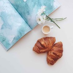 Relaxing with croissants and coffee espresso at home - FoodiesFeed