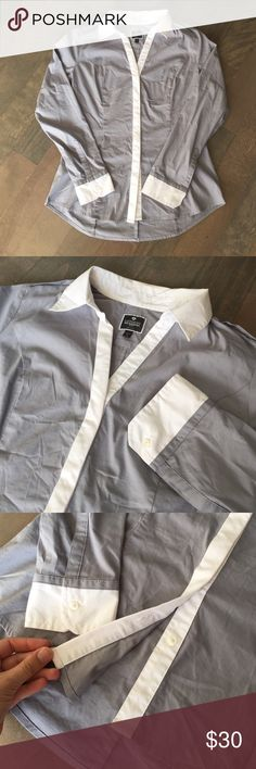 """Express Blouse! Classic, clean, professional. This """"The Essential"""" dress shirt from Express is grey with white detailing in the collar, cuffs, and button up area. Cut for a flattering look! I only wore this once - looks great, I just don't have a need for it anymore! Looking for a new home :) In excellent condition. Size medium. Express Tops Blouses"""