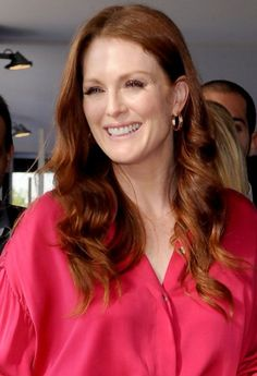 long red curly hairstyle for women over 50