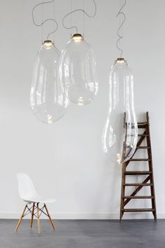 A Light Piece That Resembles Bubbles Hanging From Your Ceiling - DesignTAXI.com