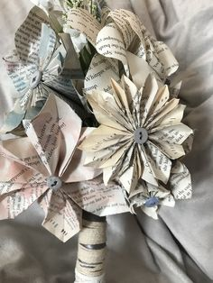 Wedding bouquet made with handmade flowers using recycled book pages.
