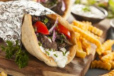 Yes, 'Gyro recipe' is spoken here. Gyros are Greek grilled lamb sandwiches with tzatziki sauce, onions, tomatoes and feta in pita bread. Much easier to make than to pronounce. Tzatziki Sauce, Kebabs, Popular Greek Food, Gyro Pita, Beef Gyro, Greek Gyros, Gyro Recipe, Shawarma Recipe, Street Food