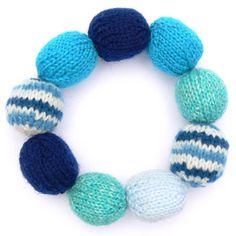 Knitted bead bracelet.  The tutorial is here:  http://www.oddknit.com/patterns/jewellery/braceletbeads.html