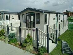 Fensys beige deck with foiled grey renolit posts to match Swift holiday home windows Plastic Fencing, Decking Suppliers, Caravan Holiday, Led Manufacturers, House Windows, Mobile Homes, Caravans, Swift, Homesteading