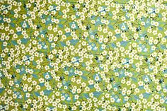 Liberty of London Tana Lawn Green and Blue by halfbakedbuttons, $30.00  Here's a place on Etsy that has it (for a couple dollars cheaper than fabric.com)