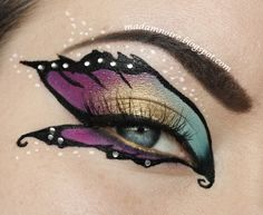 Creative and colorful butterfly inspired fantasy eye make-up with crystal accents by Madam Noire.