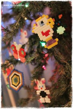 Christmas tree in a kidsroom decorated with ornaments made from Hamas-beads... www.skreytumhus.is