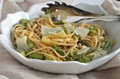 Get into the full swing of spring with this bright and lemony healthy whole-wheat pasta recipe with asparagus and fresh Parmesan!  https://greatist.com/health/whole-wheat-linguine-asparagus-and-lemon