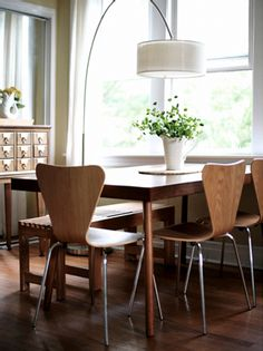 I like the wood on the table, chairs, and floor combo with the light, white, and green