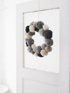 I had not considered crafting with pom poms until I saw this wreath, from sweet paul.