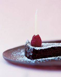 For an elegant presentation, top off the birthday cake by placing a candle inside a raspberry.