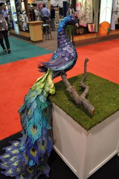 The peacock is made with DCWV paper, glitter and lots of glue! CHA Winter 2012 scrapbook, paper crafts, art