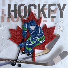 """Quilling """"Hockey Night in Canada-Canucks"""" 12""""x12""""(30cmx30cm). Hand crafted paper artwork for sale by Jan and Shannon Howard. For custom orders please contact us at quilling_in_harmony@hotmail.com"""