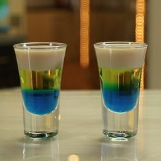 Bazooka Joe Shooters are the layered shot that could only be dreamed into existence by a bartender. These shots are creamy and fruity all at once, making use of Irish Cream, creme de banana, and blue curacao. Fruity Shots, Easy Shot Recipes, Birthday Cake Shots, Birthday Drinks, Layered Shots, Cotton Candy Grapes, Bar Shots, Shooter Recipes, Coctails Recipes