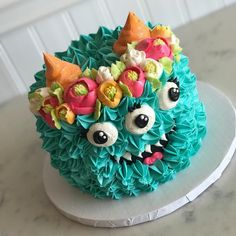 Look at that sweet boho- monster face...don't you just want to eat it up???? Well you can! Monster cakes are available through Halloween🎃💀👻 #whiteflowercakeshoppe #buttercreamflowers #buttercreamlove #monster #boho #flowercrown Bolo Original, Cake Decorating Designs, Creative Cake Decorating, Creative Cakes, Cake Designs, Cute Cakes, Fancy Cakes, Pretty Cakes, Buttercream Cake