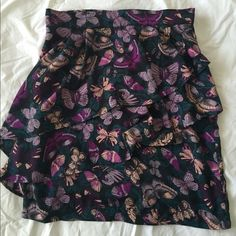 H&M purple butterfly skirt Purple ruffled skirt with a butterfly pattern by H&M. Fitted and size 8 but runs small. Good condition. Never worn by me as it is sadly too small!  As seen on Allison Argent on MTV Teen Wolf. H&M Skirts Mini