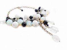 a handmade necklace full of stones, black onyx-crystals-moonstones / photo:Pavlos Kapoglou