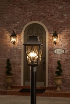 Classic details like the shepherd's crook wall mount make this 3-light outdoor post light an elegant choice for your home – and with its curving lines and clear glass panels, the carriage lantern style shades from the Altimeter collection by Park Harbor Lighting offer a timeless and appealing look.