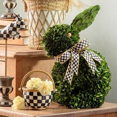 Rabbit Topiary: Decorate your spring table with this lush work of art. Donning a dapper accent of Courtly Check® ribbon, our Rabbit Topiary brings fresh spring style to your decor any time of year.