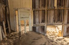 A photographic tour of the abandoned village of Kolmanskop in Namibia.