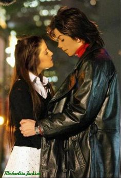 Michael Jackson & Lisa Marie Presley she was soo lucky!! I'd love to be near Mike like that!